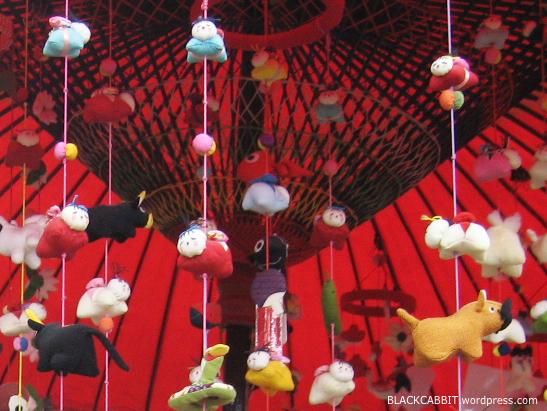 CLOSE-UP: These hanging stuffed doll decorations are also known as Tsurushi Bina, Tsurushi Hina, or Sagemon.